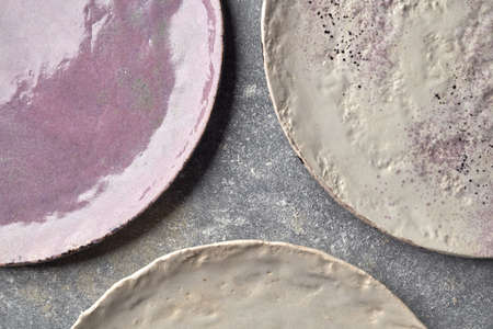 The porcelain vintage plates handmade on a gray marble table.