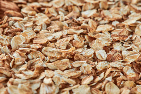 Raw oatmeal as a background, copy space. Oat cereal for dieting food, ingredients for healthy eating.