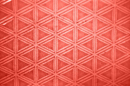 Decorative ceramic tile figured pattern in a trendy color of the year 2019 Living Coral pantone.