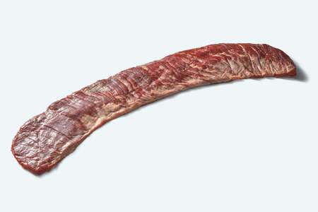 Raw beef bavette steak fore roasting isolated on a white background, copy space.