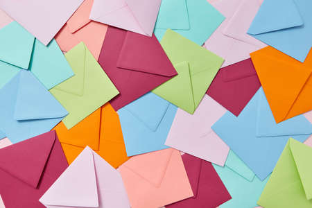 Multi colored craft envelopes pattern as a background. 版權商用圖片