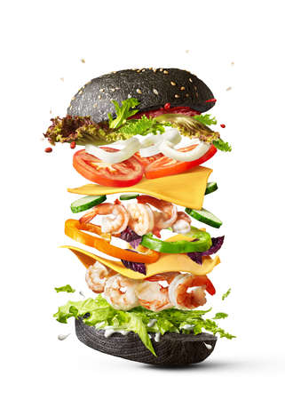Flying burger with shrimp and fresh vegetables on a white background.