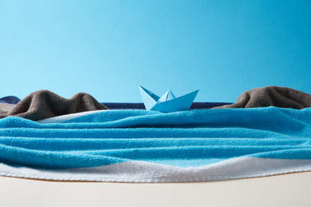 Seashore made from colored terry towels on doutone paper background. 스톡 콘텐츠
