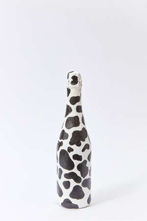 Creative white wine bottle painted with black spots.