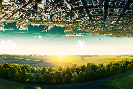 Fantastic surreal terrain of natural landscape and upside down sityscape with sea coastline. Concept of antigravity.