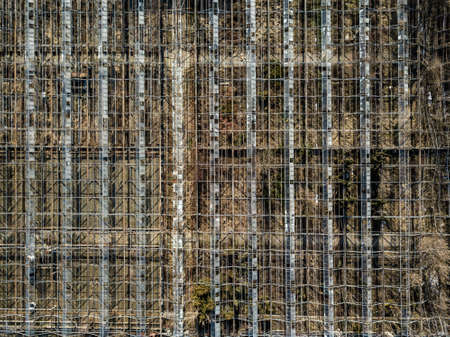 Metal framework of greenhouses on a ground of drone view. Archivio Fotografico