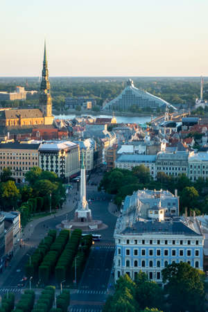 Aerial view from drone of old part Riga town, Latvia with St. Peter's Church and the Freedom Monument in a summer sunny day.
