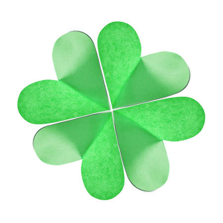Close up of green natural clover's leaf handmade from colored paper on a white background with copy space. Greeting card St.Patrick 's Day. Stockfoto