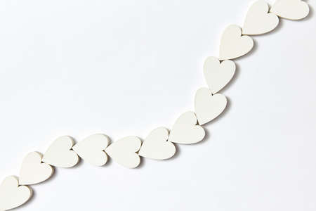 Hearts decoration in the shape of chain with soft shadows.