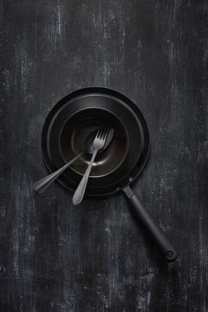 Kitchen utensils collection black colored on the came color background.