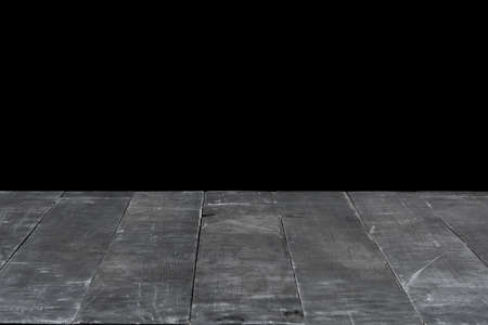 Dark grey wooden table for expose or montage your products on a black background.
