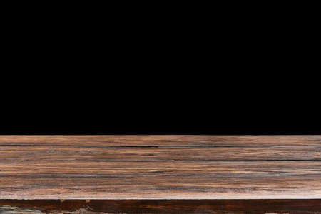 Oaken table from wooden planks on a black background for display or present your products. Banque d'images