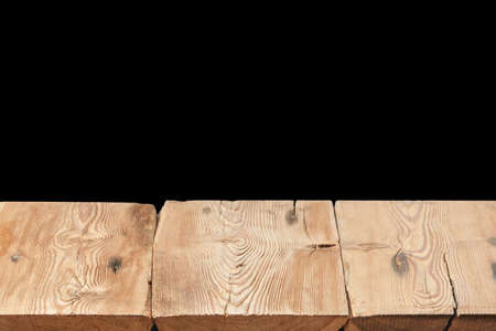 Wooden table on a black background can used for display or montage your products.