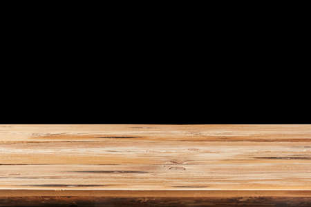 Retro wooden table on a black background can used for display or montage your products.