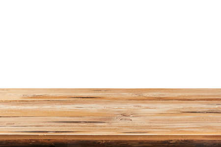 Aged natural wooden table for montage or expose products on a white background.