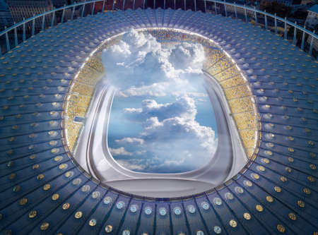 View of stadium structure with porthole and clouds.