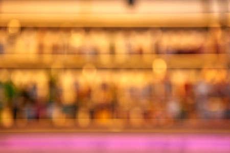 Blurred creative background of restaurant bar with pink desk space. Standard-Bild