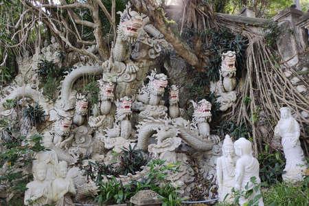 DA NANG, VIETNAM - NOVEMBER: Marble mountains scenic view near Da Nang city. White sculptures of dragons outside of cave.