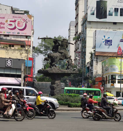 Ho Chi Minh, VIETNAM - NOVEMBER 19, 2019: Roadway of Ho Chi Minh city, a lot of bikers riding on the road. The urban landscape. Publikacyjne