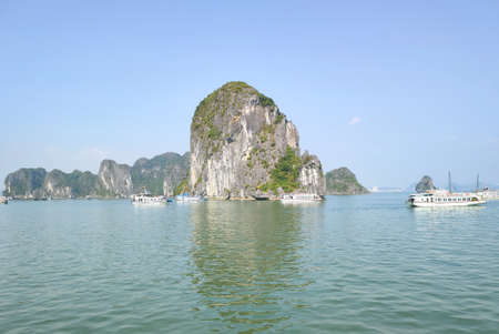 Picturesque view of UNESCO Ha Long bay. Tourist boats are floating Publikacyjne