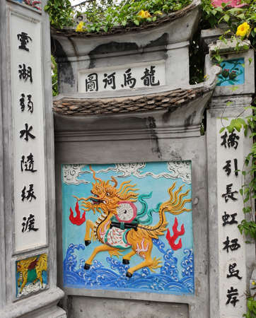 Image of the dragon is on the bridge of the rising sun, it is near the lake of the returned sword and lake of green water Ho Hoan Kiem in the center of Hanoi.