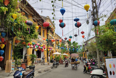 Touristic street with old buildings and lanterns in Hoi An in Quang Nam province in Central Vietnam.
