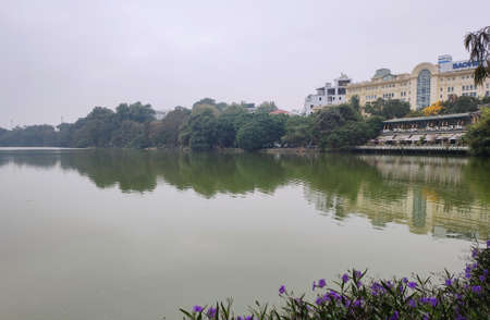 View on the lake of the returned sword and lake of green water Ho Hoan Kiem in the center of Hanoi.