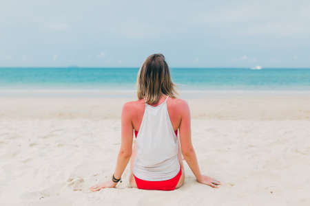 Woman in a bikini meditates on the sea. Lifestyle traveler Stock fotó
