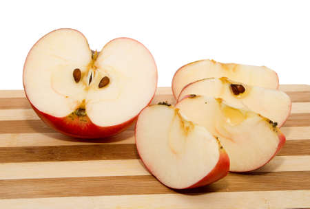 Red apple on chopping board