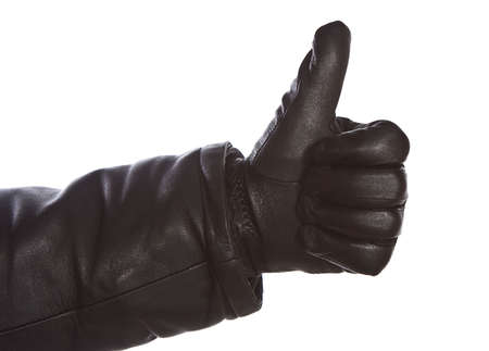 leathern: Hand in glove on  white background. Stock Photo