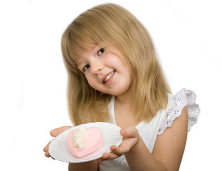 sweetmeats: Little girl with pink heart. Isolated on white background. Stock Photo