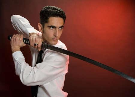 Portrait of handsome  man with sword.