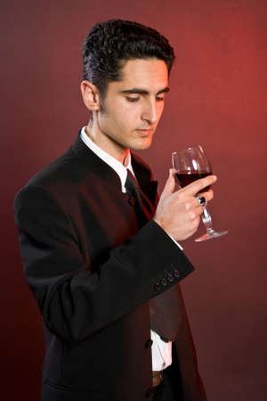 bocal: Portrait of glamour man with bocal of red wine.