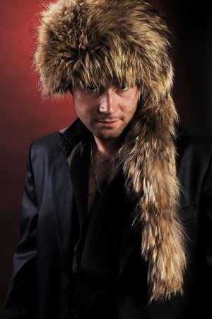 Portrait of young man in  fur-cap