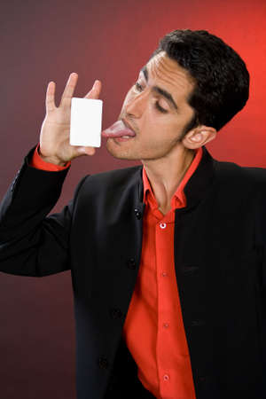 drollery: Successful businessman with plastic card.  Stock Photo