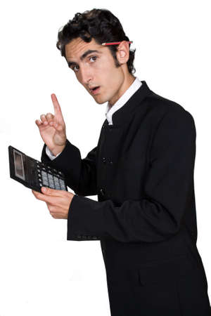 Successful businessman with big calculator and pencil.