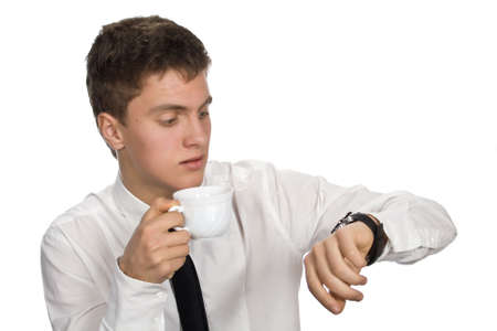 hurried: Young businessman with cup of coffee. Isolated on white background. Stock Photo