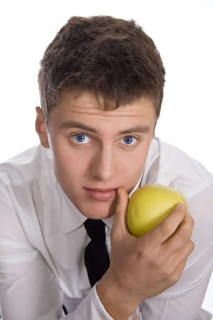 Young man with green apple. Isolated on white background. photo