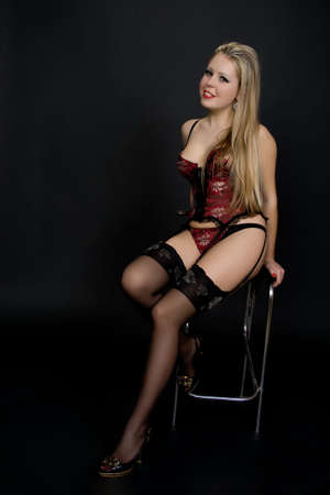 Portrait of sexy young playful woman in corset.