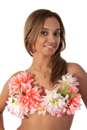 Beautiful dancer in tropical costume with flowers.