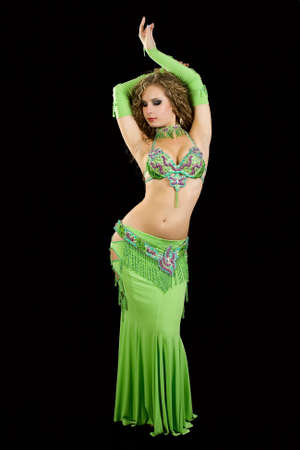 Beautiful  dancer in eastern costume on black background. Stock Photo