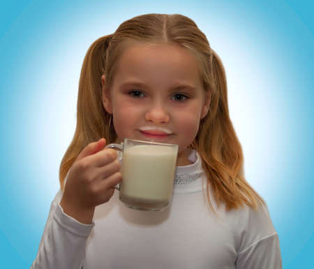 pasteurized: portrait of a young girl with a cup of milk