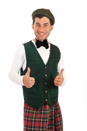 agreeable: Portrait of expressive man in Scottish costume Stock Photo