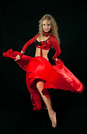 Beautiful  dancer in eastern costume on black background photo