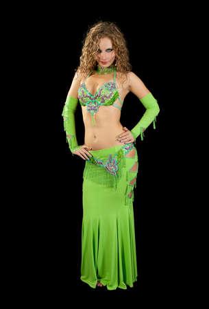 Beautiful  dancer in eastern costume on black background photo
