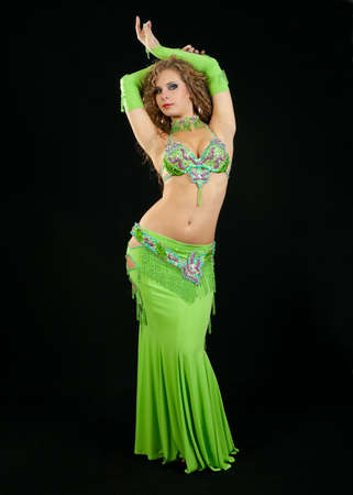 belly dancer: Beautiful  dancer in eastern costume on black background Stock Photo