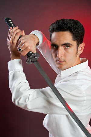 Portrait of handsome  man with steel sword. photo