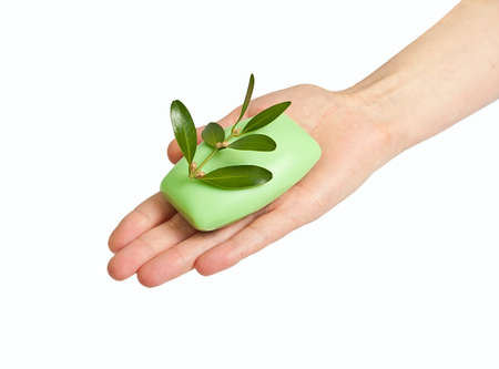 Woman hand with soap and spring. Isolated on white background photo