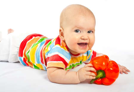 Portrait of a newborn girl with paprika on a white background photo