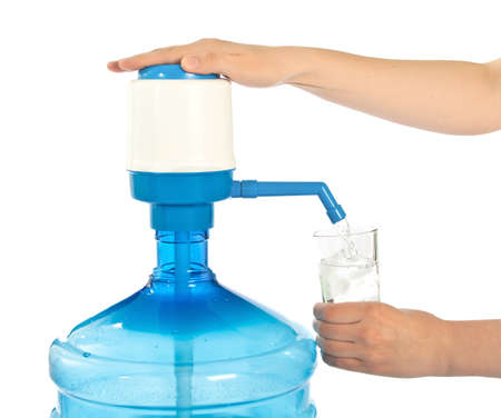 Large bottle of clean drinking water and hand with glass. Stock Photo